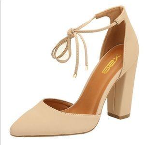 Nude front tie heels
